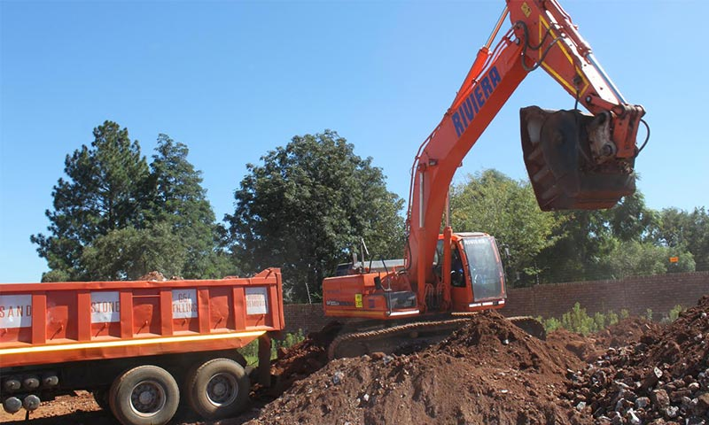 At the Centurion site, the excavator and bucket crusher combination is used to crush material for platforming.