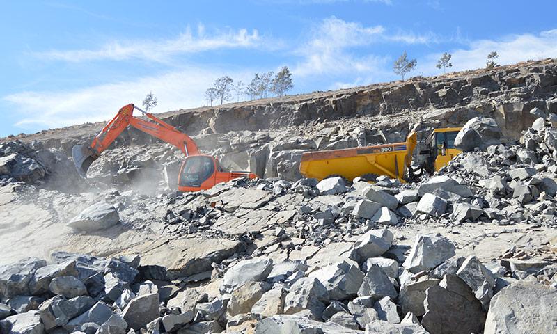 A-Doosan-225-excavator-loads-the-dumper-inside-the-quarry-pit